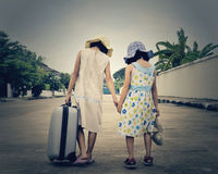 two little kids with a suitcase escape from house Royalty Free Stock Photos