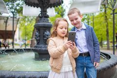 Two little kids taking selfie outdoor. Love friendship fun concept. Small adults royalty free stock images