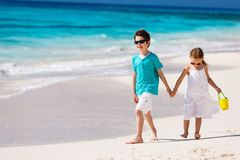 Two kids at beach. Two little kids at a tropical beach stock image