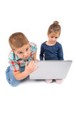 Two little kids using a laptop Stock Photo