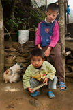Two little Lepcha boys and hen family Royalty Free Stock Photography