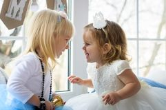 Two little lovely smart girls in the New Year`s environment are Royalty Free Stock Image