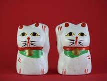 Two little Maneki Neko, Japanese lucky cats, amulets that bring good luck. Two little Maneki Neko, Japanese lucky cats, amulets that bring good luck, protection stock photos