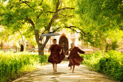 Two little monks. Running outdoors stock photos