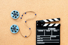 Two little movie reel connected with filmstrip path Stock Photography