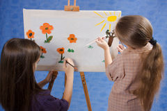Two little painters. At work Stock Photos