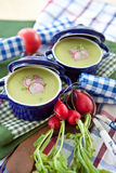 Two little pots with green soup and beets Stock Photo