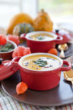 Two little pots with pumpkin soup Stock Image