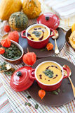 Two little pots with pumpkin soup Royalty Free Stock Photo