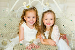 Two little princess near the table Royalty Free Stock Image
