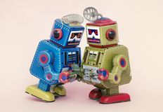 Two little robots share some gossip Royalty Free Stock Images