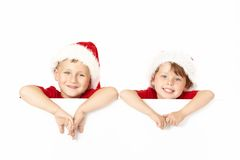 Two little santa Stock Image