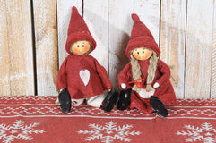 Two little santa decoration on wooden background. Christmas decoration. Christmas toy. Vintage style, over wood background Stock Photos