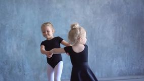 Two lovely girls. Future ballerinas of the Russian ballet. Two little schoolgirls of ballet school have fun. Two little schoolgirls of ballet school have fun stock video footage
