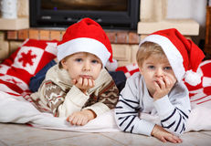 Two little sibling boys being happy about christmas present Royalty Free Stock Photography
