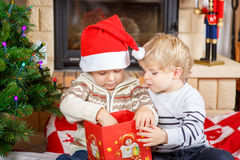 Two little sibling boys being happy about christmas presents Royalty Free Stock Images