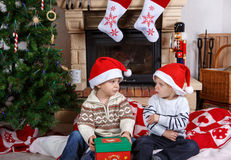 Two little sibling boys fighting about christmas present Stock Images
