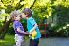 Two little sibling boys hugging and having fun outdoors Royalty Free Stock Photography