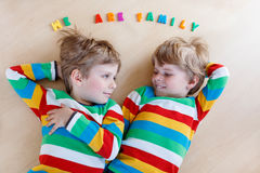 Two little sibling kid boys having fun together, indoors Royalty Free Stock Photo