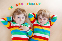 Two little sibling kid boys having fun together, indoors Royalty Free Stock Photography