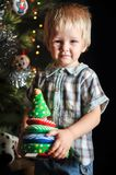 Two little sibling kid boys holding christmas tree. Happy children decorate xmas tree in yours house. Family, tradition, celebrati. On concept Royalty Free Stock Photography