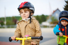 Two little siblings having fun on bikes in city on vacations Royalty Free Stock Photography
