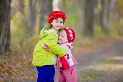 Two little sisters embrace each other Stock Images