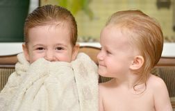 Two little sisters after bath Stock Image