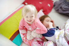 Two little sisters in bed on sunny morning Stock Image