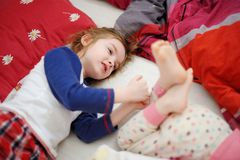 Two little sisters in bed on sunny morning Royalty Free Stock Photos