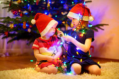 Two little sisters decorating a Christmas tree Stock Photography