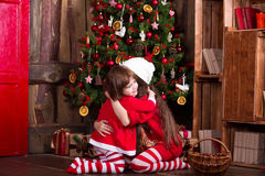 Two little sisters decorating Christmas tree. New Stock Photo