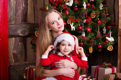 Two little sisters decorating Christmas tree. New Stock Image