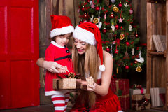 Two little sisters decorating Christmas tree. New Stock Photos