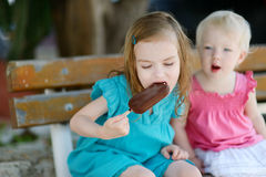 Two little sisters eating ice cream Royalty Free Stock Image
