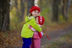 Two little sisters embrace each other Royalty Free Stock Image