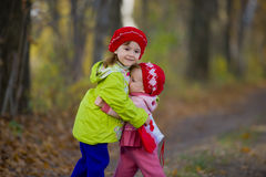 Two little sisters embrace each other Royalty Free Stock Photo