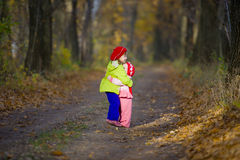 Two little sisters embrace each other Stock Photo