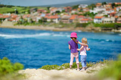 Two little sisters enjoying a view Royalty Free Stock Photography