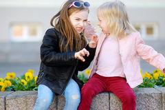 Two little sisters fighting Stock Image