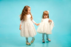 Two little sisters in a fine white dresses Royalty Free Stock Photo