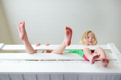 Two little sisters fooling around, playing and having fun in twin bunk bed Royalty Free Stock Photo