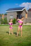 Two little sisters frolicing and splashing in Royalty Free Stock Photography