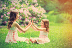 Two little sisters have a fun Stock Photos