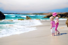 Two little sisters having fun on a beach Royalty Free Stock Photos