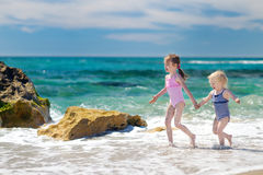 Two little sisters having fun on a beach Stock Photography