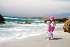 Two little sisters having fun on a beach Royalty Free Stock Photography
