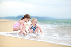 Free Two Little Sisters Having Fun On A Beach Stock Images - 41446684