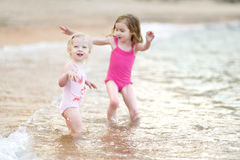 Free Two Little Sisters Having Fun On A Beach Stock Images - 41458424