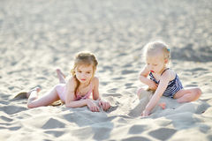 Free Two Little Sisters Having Fun On A Beach Royalty Free Stock Image - 43670376